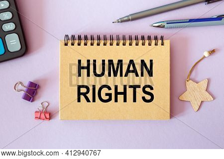 Human Rights- Written On A Notepad On An Office Desk With Office Accessories.