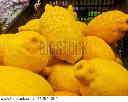 Large Ripe Lemons Are Sold At The Grocery Store In The Fruits And Vegetables Section.