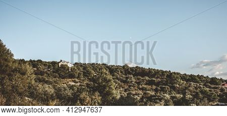 House Surrounded By Trees In A Forest In The Croatian Mountains. Summer Landscape