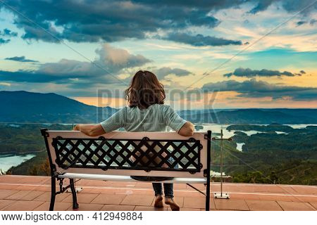 Woman overlooking amazing view of Ta Dung lake. Vietnam. Panorama landscape