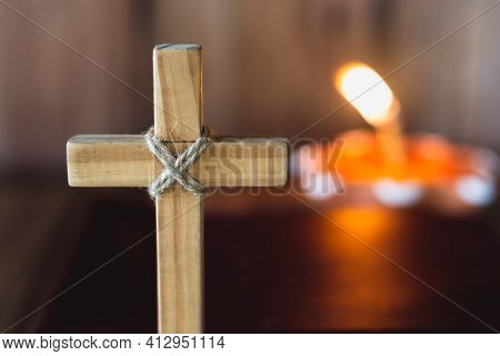 The Cross Has A Candle That Illuminates. Christian Religious Concept, The Crucifixion Of Faith And F