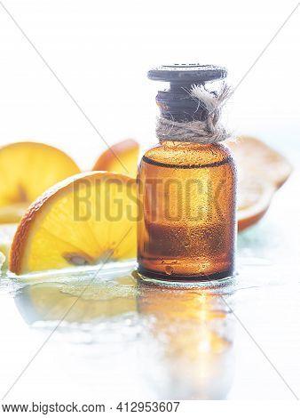 Vitamin C Serum And Fresh Citrus Fruits. Citrus Essential Oil. Natural Cosmetics Concept. Organic Co