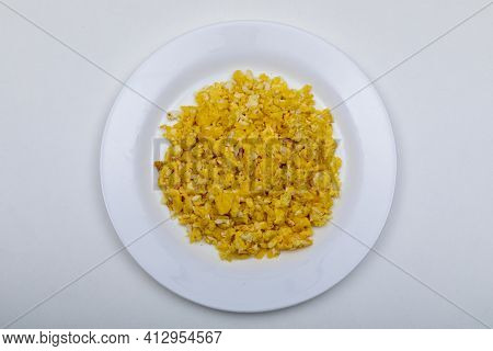Healthy Diet Breakfast Concept. Scrambled Eggs Over White Stone Background. Top View