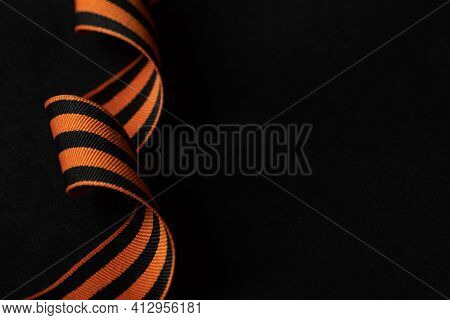 St. George's Ribbon On Dark Background. May 9 Victory Day In The Great Patriotic War Of 1941-1945