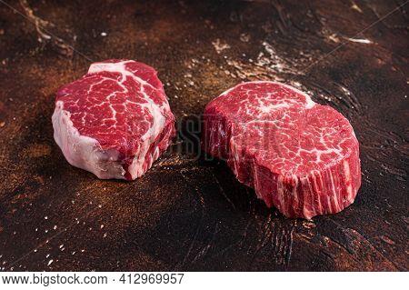 Raw Fillet Mignon Tenderloin Steaks. Dark Background. Top View