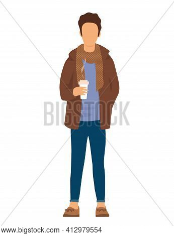 A Young Man Is Standing In Street Clothes. Dressed In A Jacket With A Scarf. Cup Of Hot Coffee In Ha