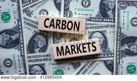 Carbon Markets Symbol. Concept Words 'carbon Markets' On Wooden Blocks On A Beautiful Background Fro