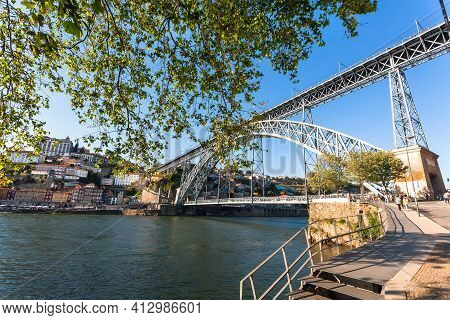 Porto, Portugal: Riverfront And Huge Double-deck Metal Arch Bridge In Historical City On 19 May, 201