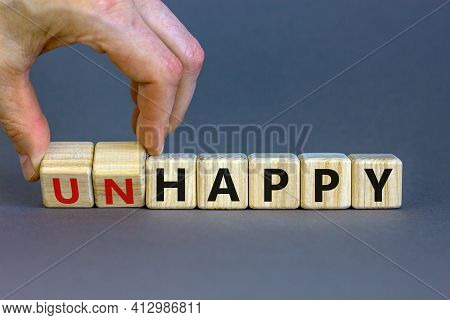 Be Happy, Do Not Unhappy Symbol. Businessman Turns Wooden Cubes And Changes The Word 'unhappy' To 'h