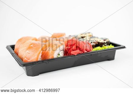Take Away Sushi In Plastic Containers, Philadelphia Rolls And Unagi Maki, Soy Sauce, Pink Ginger, Wa