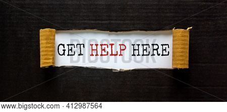 Support And Get Help Here Symbol. Words 'get Help Here' Appearing Behind Torn Black Paper. Beautiful