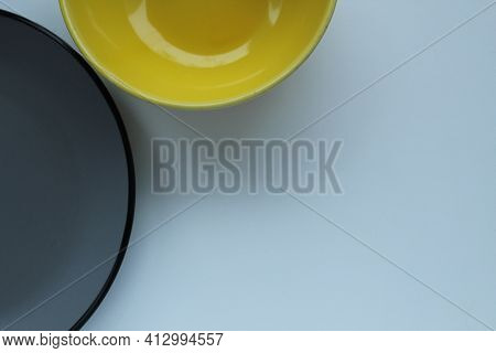 Plates Of Yellow Gray On A Light White Background With A Ist For Text And A Copyspace