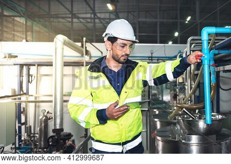 Caucasian Engineer Man, Or Technicians Are Using Tablet And Checking The Operation Of  Equipment, In