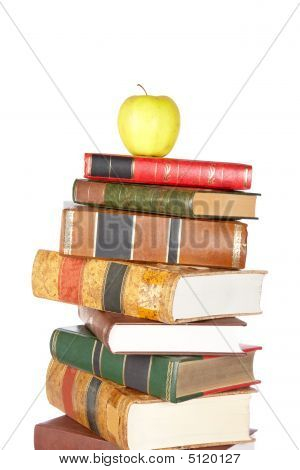 Yellow Apple On Pile Of Books