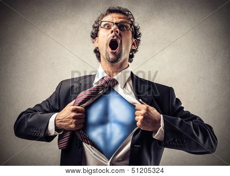 businessman unbuttons his suit and becomes superman