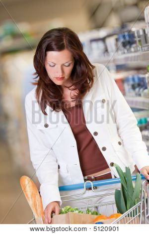 Shopping Series - Young Woman In A Supermarket