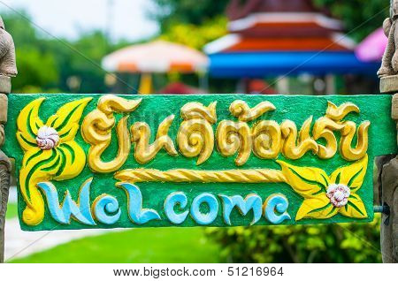 Thai and English in welcome