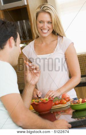 Husband And Wife Preparing Dinner