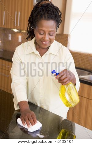 Woman Cleaning Kitchen Counter