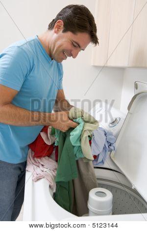 Man Loading Washing Machine