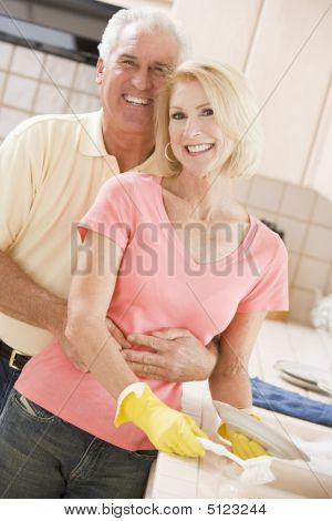 Husband And Wife Cleaning Dishes