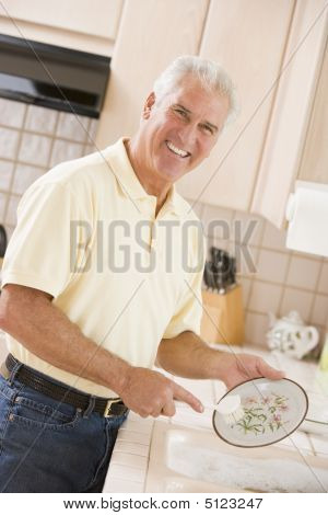 Man Cleaning Dishes
