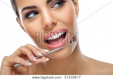 young woman with healthy teeth and dental mirror