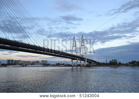 Cable-braced bridge across the river Neva at evening St. Petersburg Russia poster