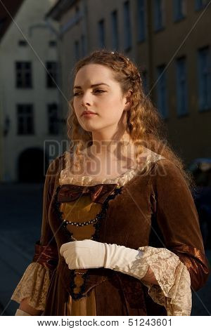 Medieval style girl at the street of  tallinn