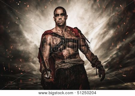 Wounded gladiator  with sword against stormy sky  poster