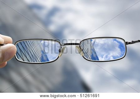 vision of a glass business building through glasses