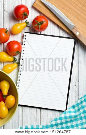 tomatoes with blank recipe book
