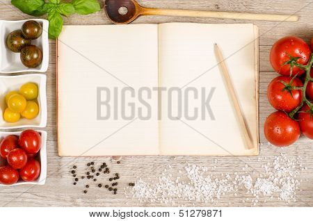 Old Book With Advertising Space And Pencil, Wooden Spoon And Tomatoes