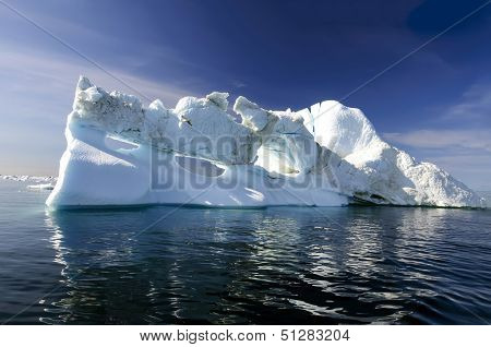 Three Holes Iceberg Floating In Disko Bay, Greenland