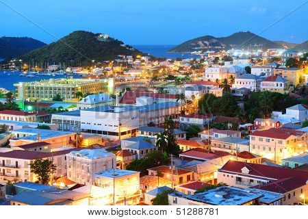 Virgin Islands St Thomas mountain view in early morning with buildings and beach coastline.