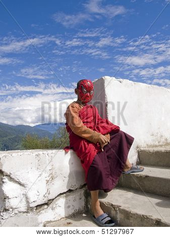Thimpu, Bhutan - October 20, 2010: Buddhist Monk With Spiderman Mask On
