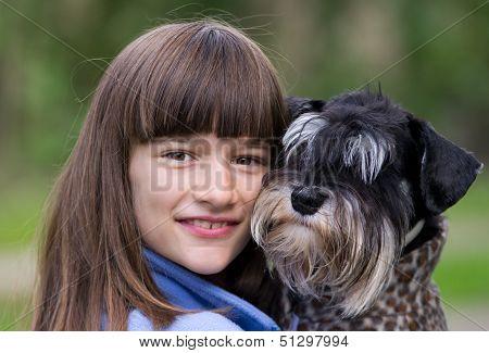 Girl hugs her pet
