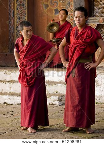 Trongsa, Bhutan - October 23, 2010: Anxious Looking Monks Waiting For Their Rehearsal For The Trongs