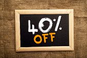 Fourty percent off discount tag on blackboard. poster