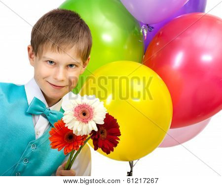 Smiling boy with balloons and  bouquet of flowers