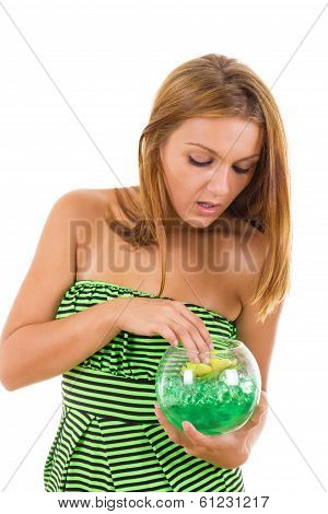 Curious Girl With Glass Bowl And Flower Inside