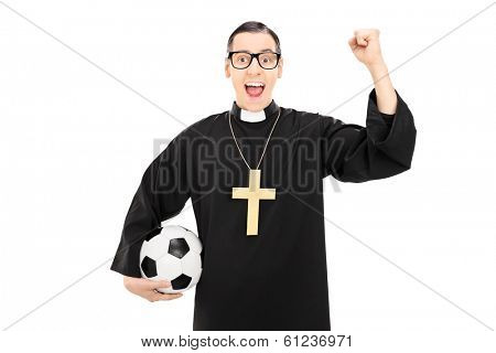 Male reverend holding football and raising a fist isolated on white background