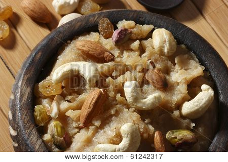 Atte ji sero is flour based dessert made with wheat flour, ghee and dry fruits poster