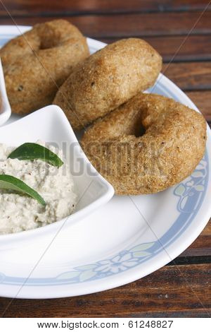 Vada also known as vadai,Medu vada, wada or vade, is a savoury snack from South India, shaped like a doughnut and made from dal, lentil or potato. It is a traditional South Indian food known from antiquity.Vada can vary in size and shape, the Indian vada poster