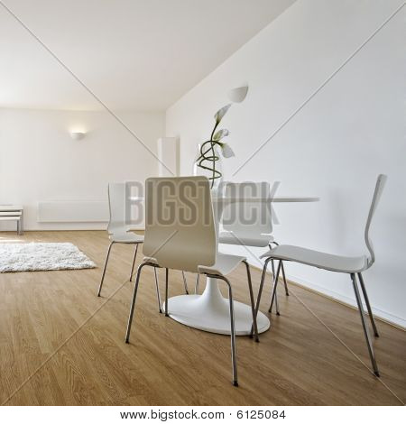 round dining table with seats for four