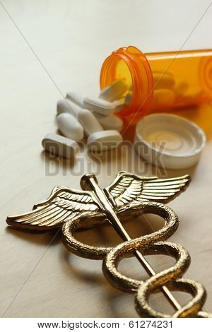 Medical concept, caduceus and pill bottle