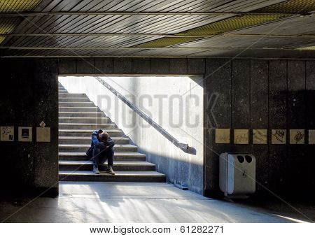 Lonely man sitting on stairs