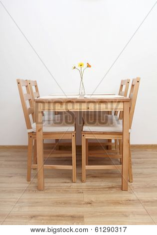 Dinning table and chairs  in empty  room.