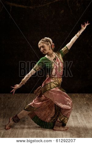 Vintage retro style image of young beautiful woman dancer exponent of Indian classical dance Bharatanatyam