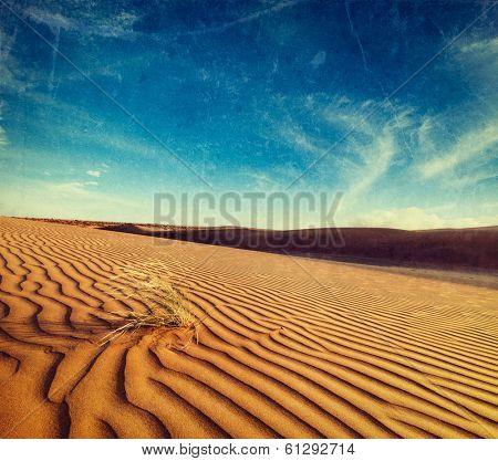 Vintage retro hipster style travel image of dunes of Thar Desert. Sam Sand dunes, Rajasthan, India with grunge texture overlaid